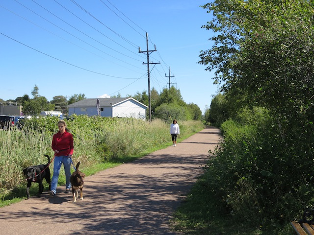 Cycling Confederation Trail in PEI, from Charlottetown, people walking