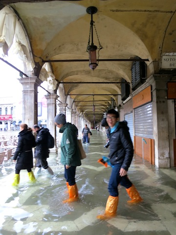 Tourists in flooded Venice
