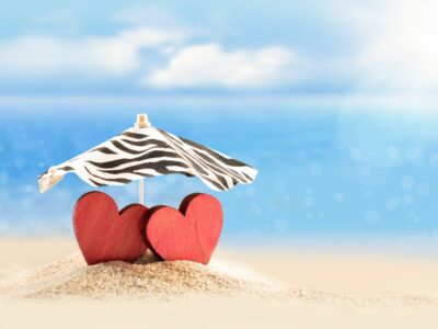 two red hearts on a beach