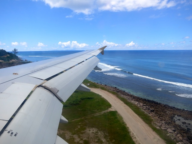 Airplane flying in to Seychelles