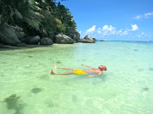 Man floating in the Indian Ocean Seychelles