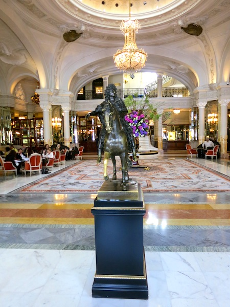 Statue of Louis XIV in lobby of Hotel de Paris