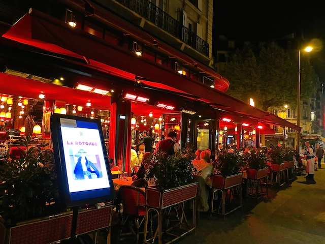 Historic Montparnasse cafes Paris, La Rotonde at night