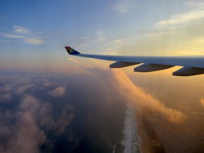 Travel literature and travelling, an airplane in flight