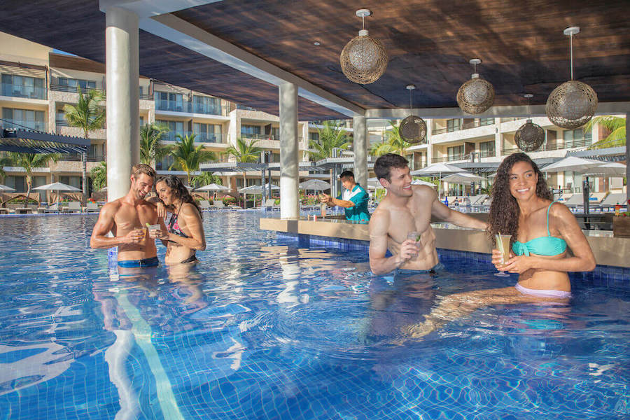 happy couples in pool at hideway royalton adult only resort