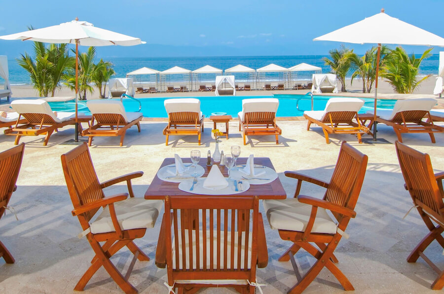 table by pool at the adults only mexico casa velas resort