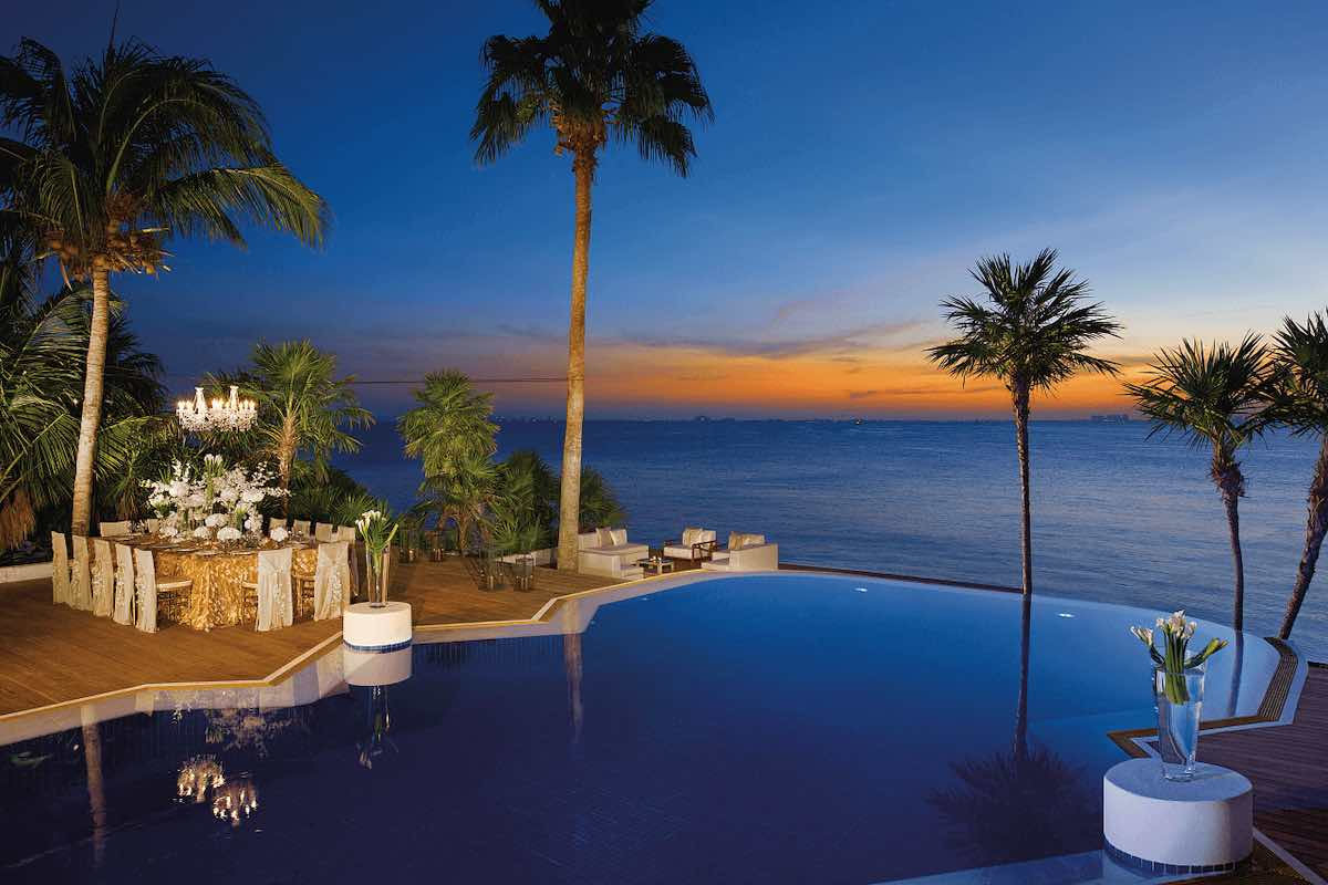 zoetry mexico all inclusive resort pool at sunset
