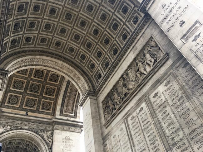 Romantic Paris inside the arch of Arc di Triomphe