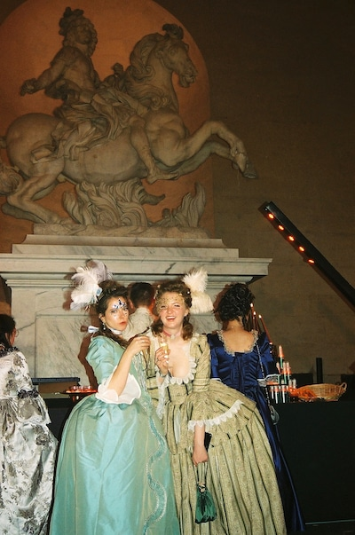 Two young women in costume at the Masked Ball in Versailles France