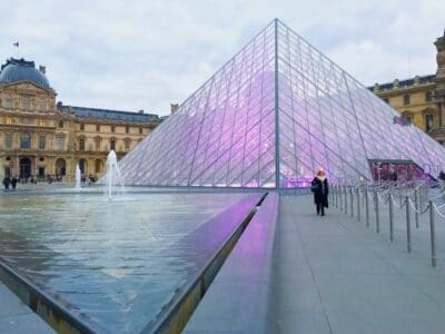 The lit up pyramid at the Louvre in Paris, one of the world's most artistic cities