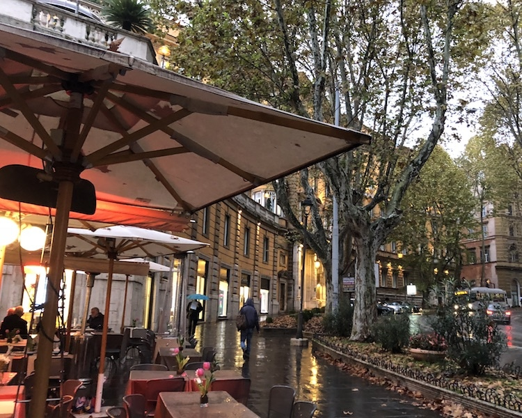 Cafe with red umbrella at Via Veneto Rome