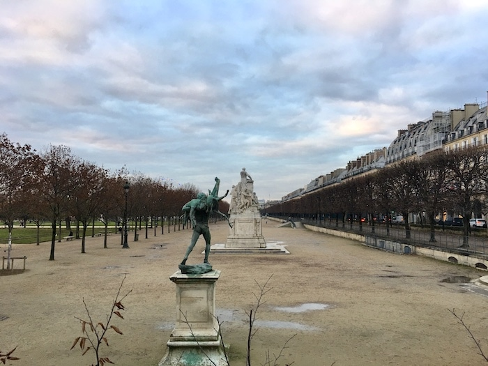 Shot of a Paris park under a cloudy sky