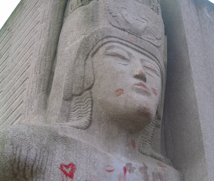 Oscar Wilde tomb in Paris, close up shot of winged angel