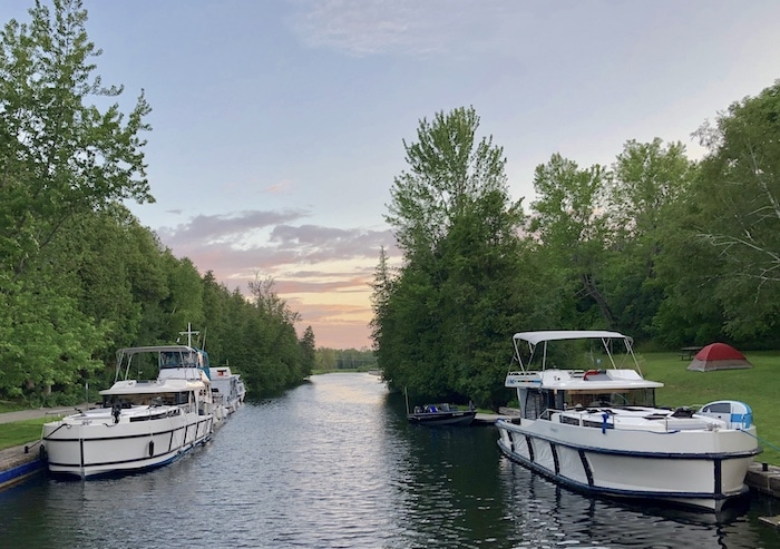 Our boat rental on the Rideau Canal at sunset