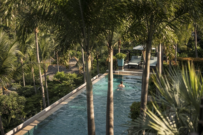 Lush outdoor pool at Four Seasons Koh Samui, one of the best beach resorts in Thailand