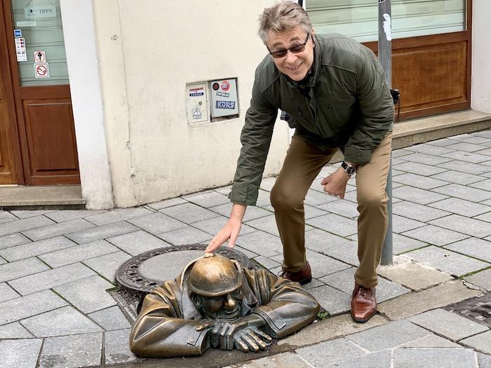 Sculpture of man in manhole Bratislava