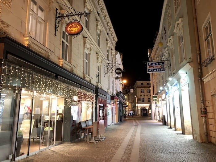 Landstrasse pedestrian street at night in Krems, Austria