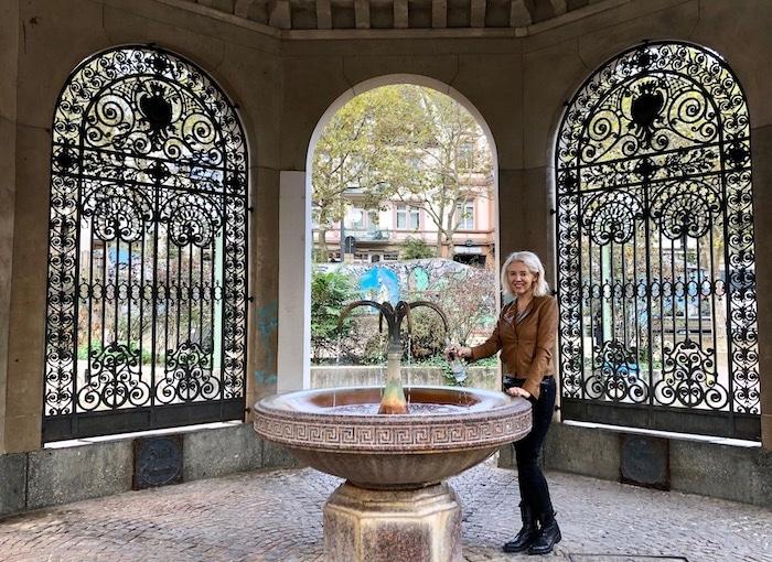 Wandering Carol drinking mineral water in Wiesbaden