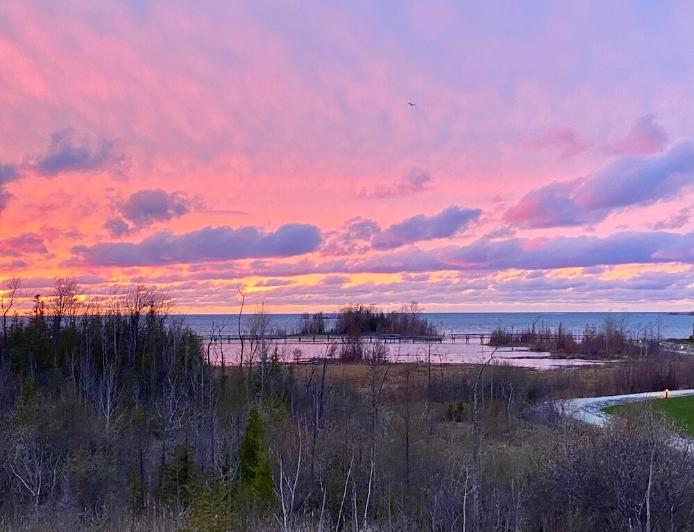 beautiful pink and lavender sunset in collingwood on southern georgian bay ontario
