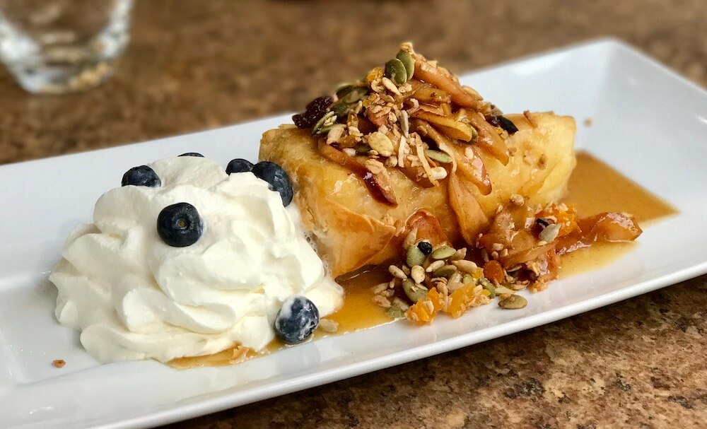 pastry with apple and whipped cream on the apple pie trail in collingwood