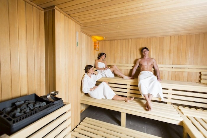 3 people in a sauna