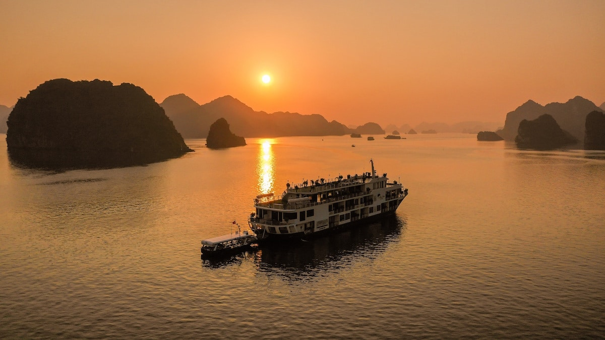 sunset view of a luxury halong bay cruise ship