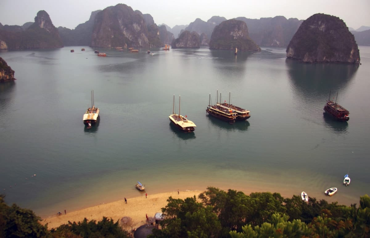 quiet beach on halong bay in vietnam with karst formations