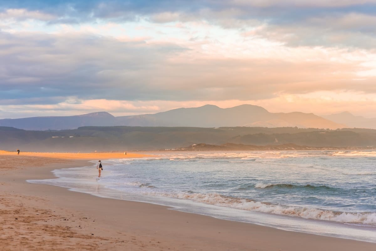 pale pink sunset photo of plettenberg bay beach