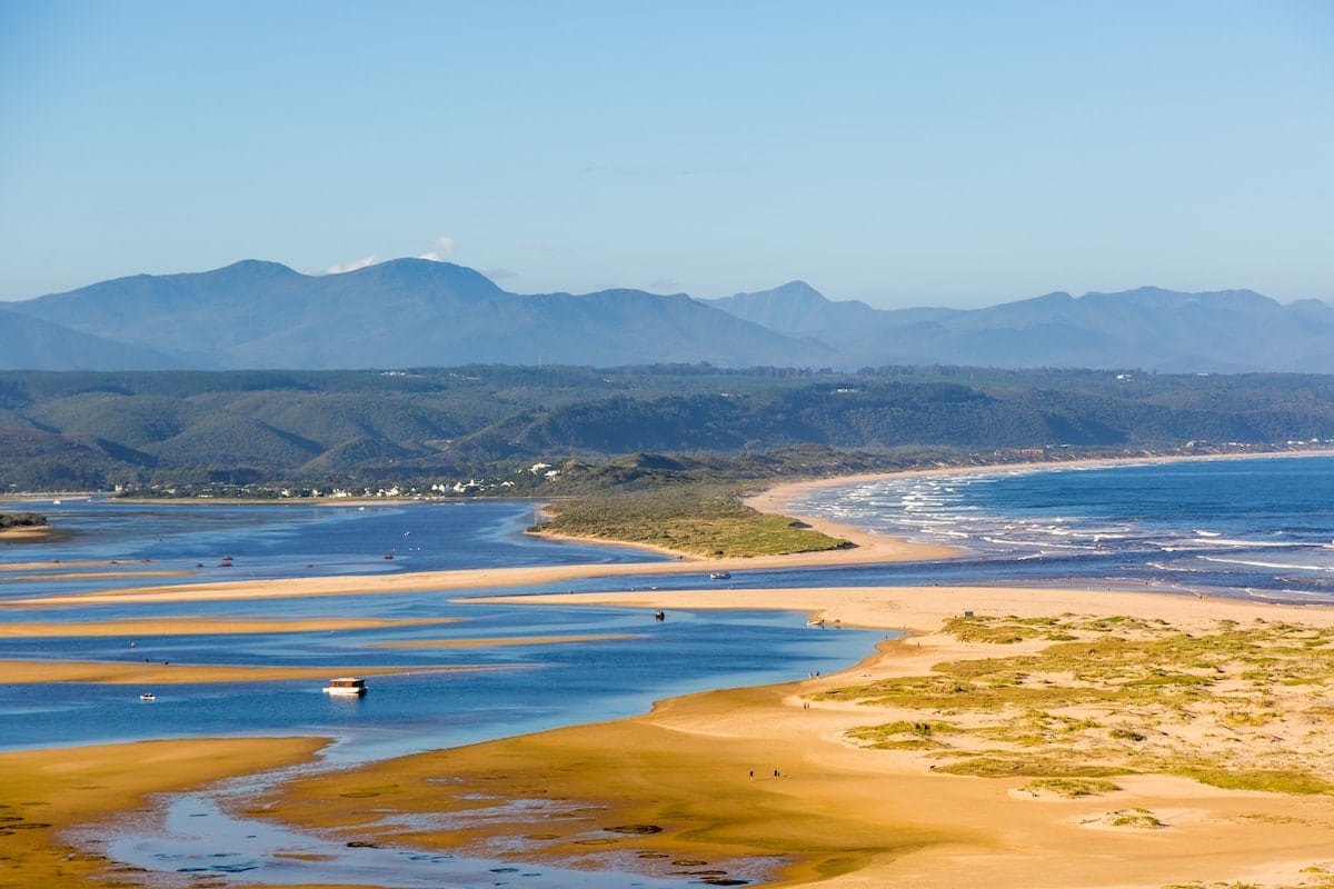 panoramic view of the beach, water and mountains at knysna in south africa